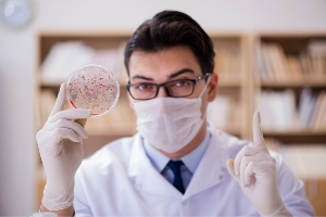Scientist Holding Up Petri Dish