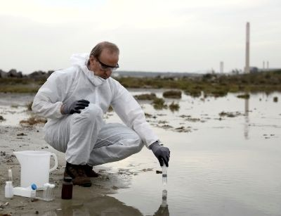 man testing pollutants in water