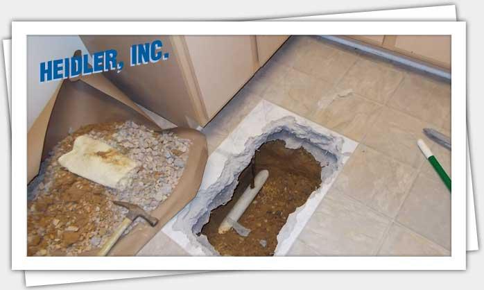 Hot water slab leak cost